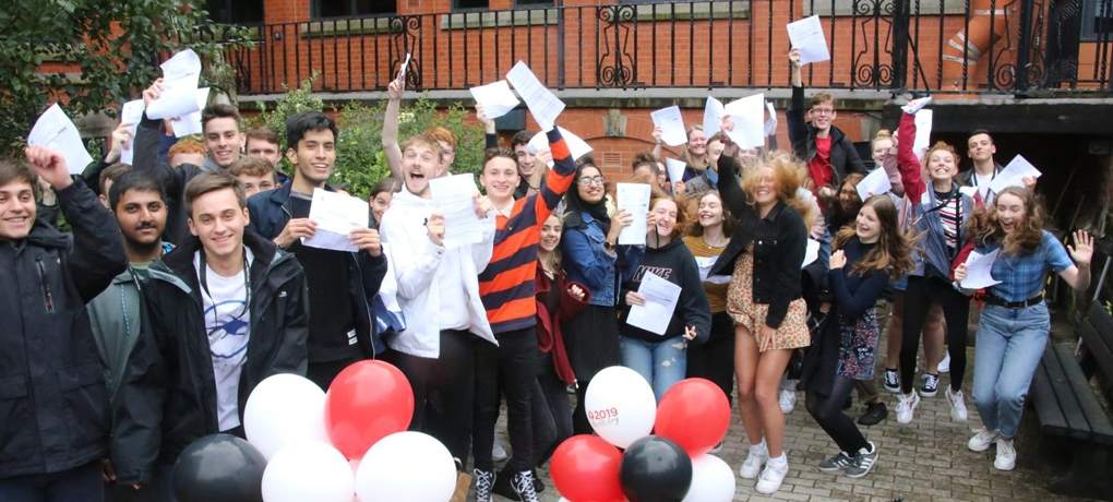 Group of happy students having received their exam results