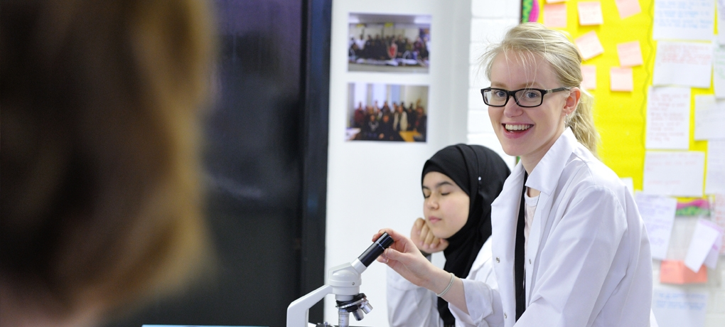 Students in a science class at Holy Cross wearign a lab coat