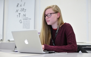 Student on a laptop computer at Holy Cross College