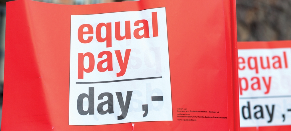 Image of a banner which says 'equal pay day'