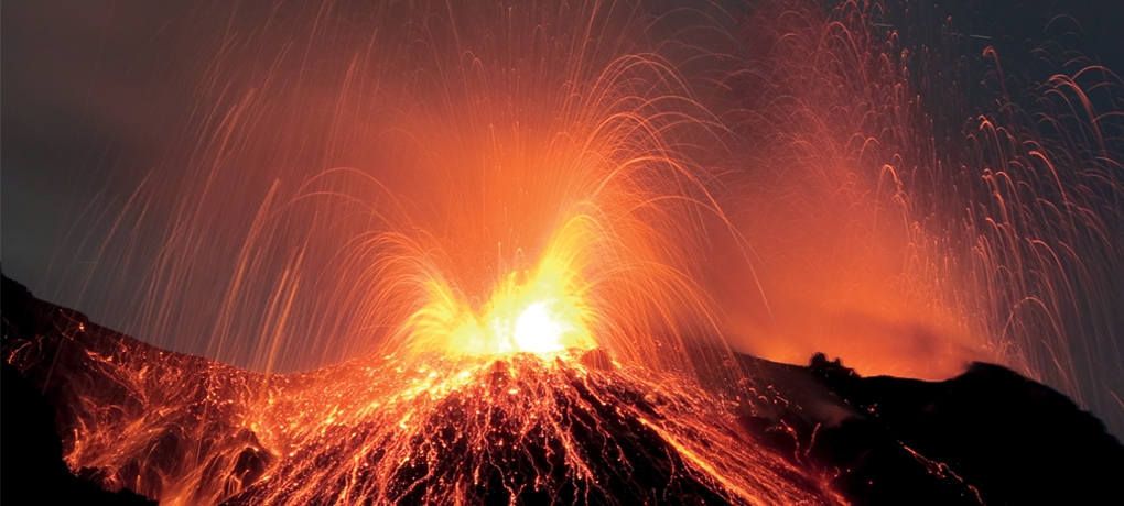 A volcano erupting to illustrate the A Level Geography Course