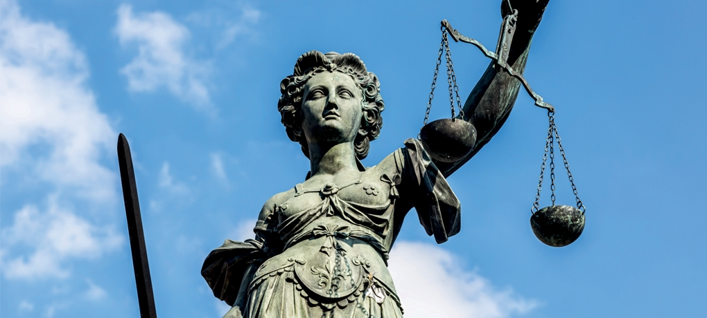 Justitia (Lady Justice) sculpture used to symbolise the A Level Law Course