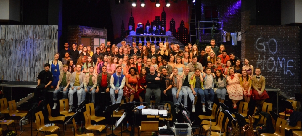 Cast of the latest Holy Cross production on stage