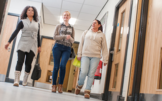 Students walking down a corridor at Holy Cross University Centre