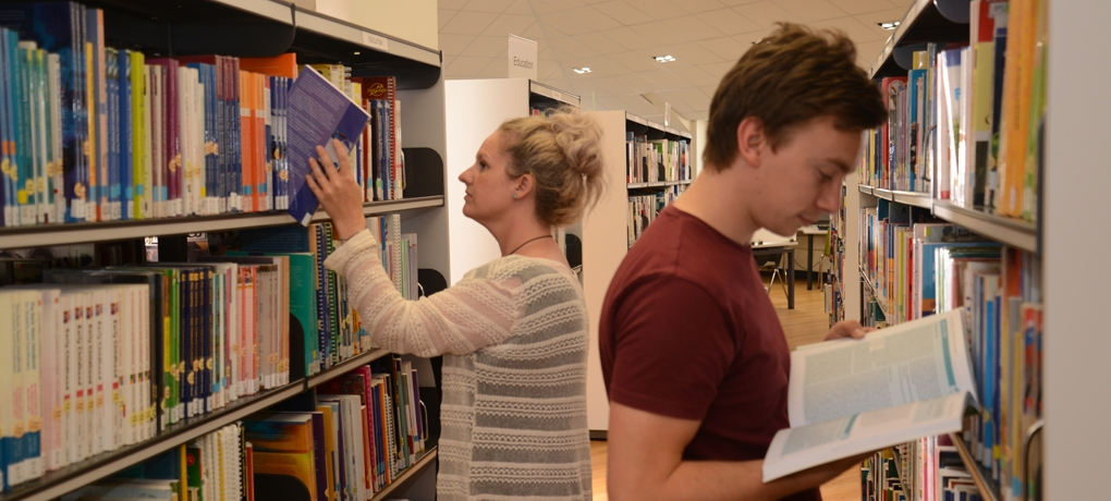 Students in the library at Holy Cross University Centre